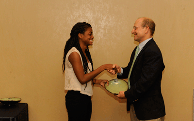 Photo of Alexis Harrison as she receives her award from Office of Sustainability Director, Mike Kensler.