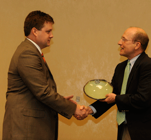 Photo of Award recipient Judd Langham receives his award from Mike Kensler, <a href=
