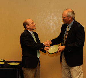 Photo of Award recipient Michael Hein receives his award from Mike Kensler, <a href=