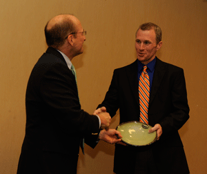 Photo of Award recipient Trey McDonald receives his award from Mike Kensler, Director of the Office of Sustainability at Auburn University.