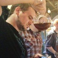 Photo of Wade Preston perfecting his barista skills.