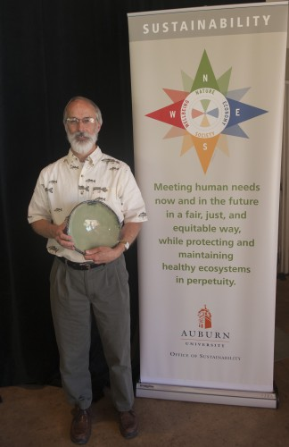 Photo of Dr. Dennis DeVries with his Spirit of Sustainability Award.