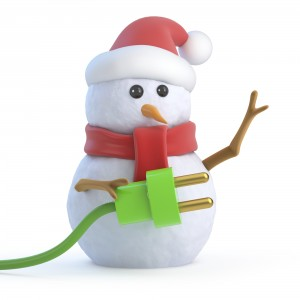 Photo of a snowman wearing a Santa Claus hat and holding a green power cord