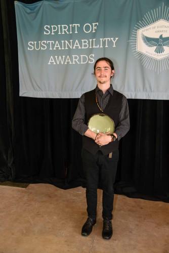 Photo of Sam Price with his Spirit of Sustainability Award bowl.