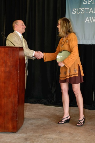 Photo of Mike Kensler, Director of Sustainability, presenting the award for Southern Foothill Farms to Rita Grub, who is accepting on behalf of Brian and Liz Simpson.
