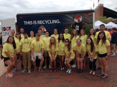 Gameday Recycling student volunteers pause for a quick photo before distributing recycling bags to tailgaters.