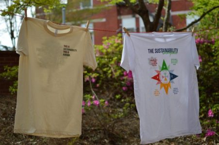Photo of t-shirts on a clothesline.