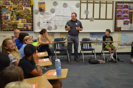 Photo of Dr. Mark Wilson talking with young students.