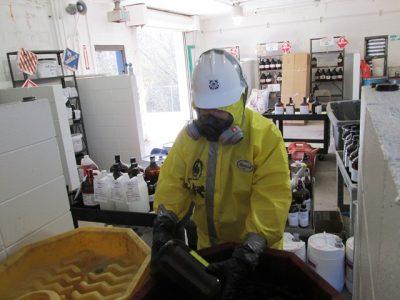 Photo of Michael at work ensuring the proper handling of hazardous materials.