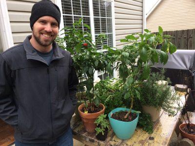 Photo of Jonathan Lillebo with plants.