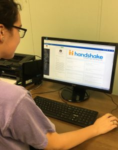Photo of student using the Handshake job platform.