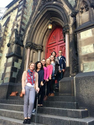 Interns standing on steps of historic building at the sustainability conference