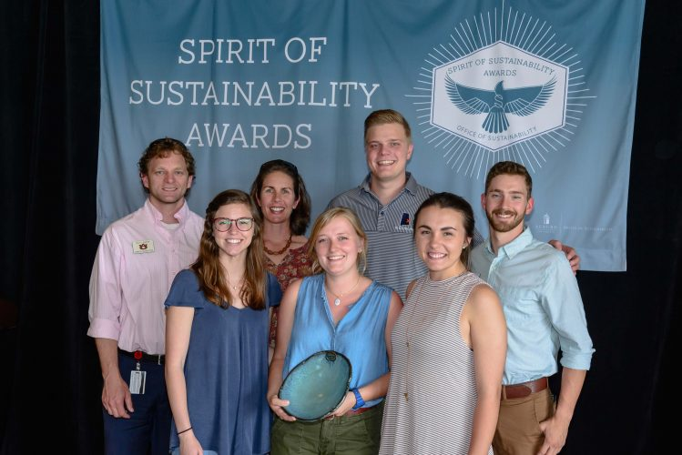 Photo of Auburn Outdoors staff accepting their award.