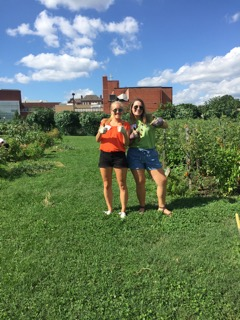 Kenzley and Ginny help out in an urban garden during the DC Central Kitchen Boot Camp
