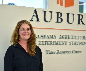 Mona Dominguez poses in front of the Alabama Agriculture Experiment Station