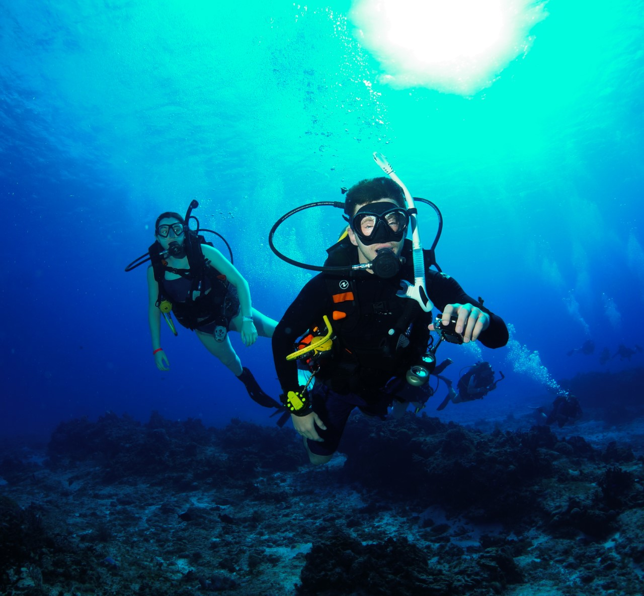 Auburn students Randall Dunlap and Kelly Burnham scuba diving