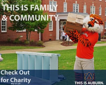 A photo of Aubie carrying boxes.