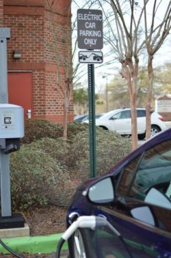 A Chevy Volt charging at an electric car charging station.