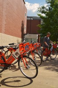 A student checking out a bike from a War Eagle Bike Share hub station.