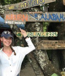 Lauren posing in front of an Auburn, Alabama sign in Costa Rica.