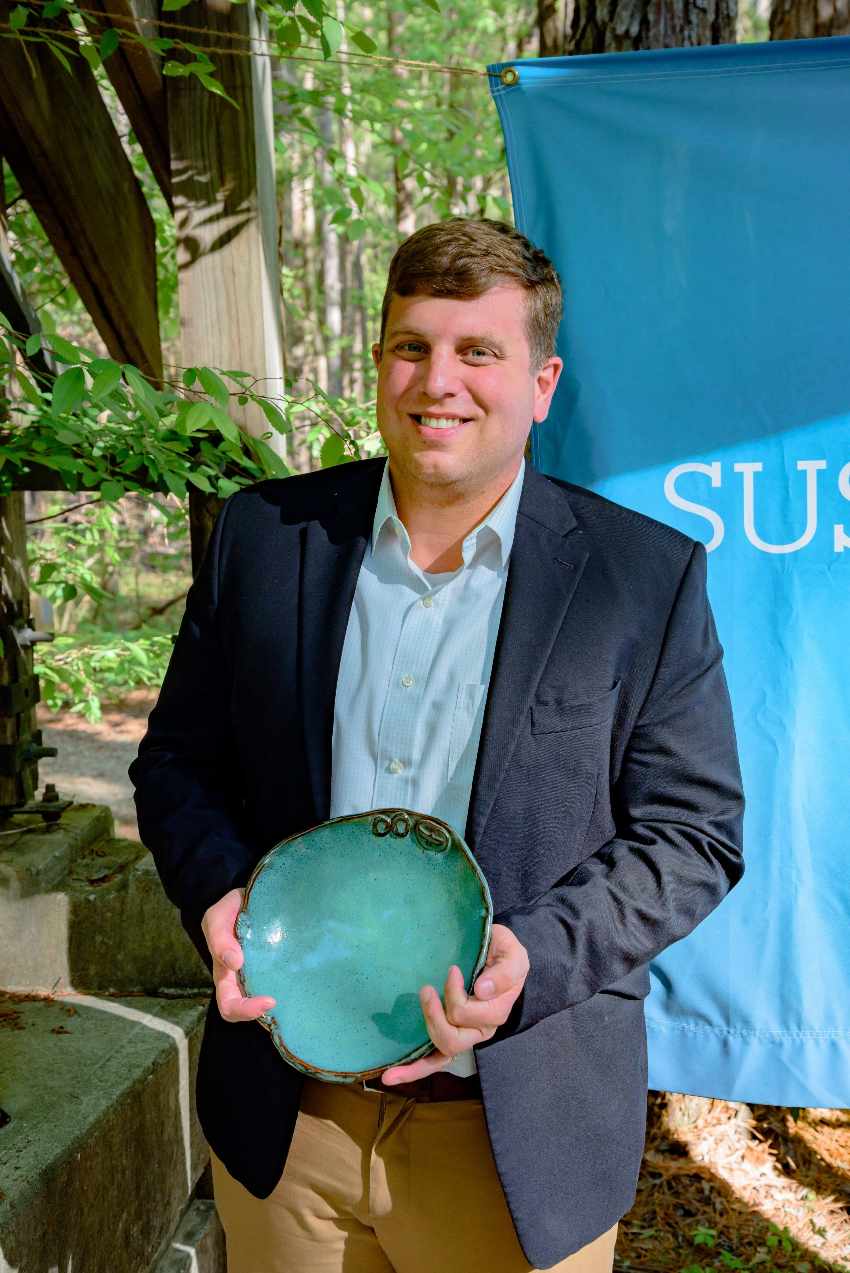 Photo of Ben Burmester with his Spirit of Sustainability Award